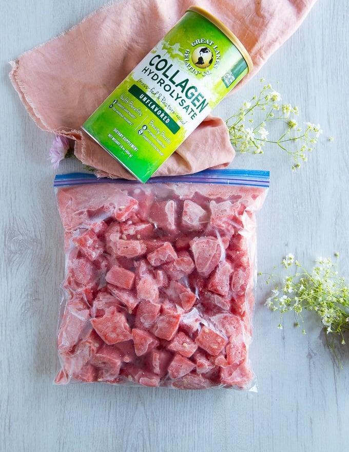 fully frozen watermelon chunks in a ziploc bag