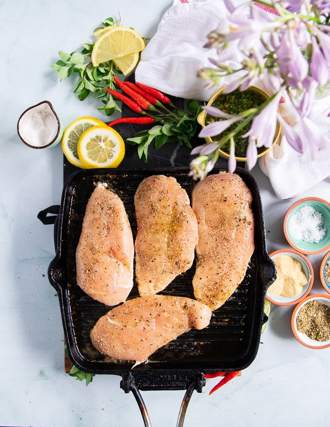 chicken breasts cooking over a grill griddle to make chicken chimichurri