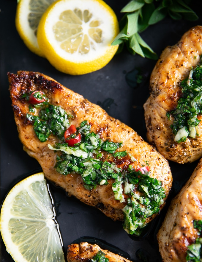 close up of one chicken drizzled with chimichurri recipe