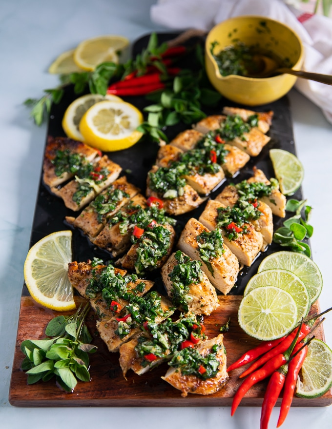 easy delicious chicken chimichurri served next to a bowl of chimichurri recipe
