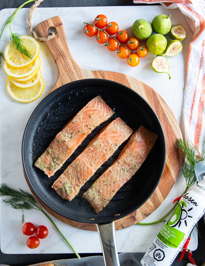 salmon fillets marinated and placed in a stove top grill pan