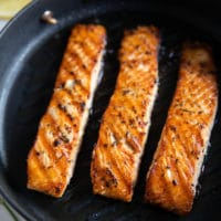 ready stove top grilled salmon in a stove top grill showing the texture and char on the salmon