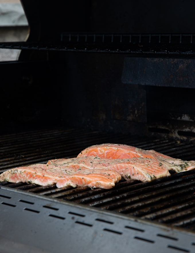 marinated salmon fillets on a BBQ grill