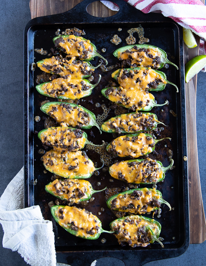 Baked jalapeno poppers recipe out of the oven with the cheese melted ontop